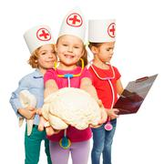 Doctors with x-ray, tooth dummy and cerebrum model Stock Photos