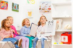 Little oculist and patients at the doctor's room - stock photo