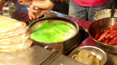 Thai pancake in cooking pan with green topping Stock Footage