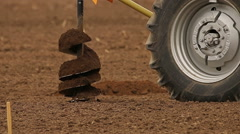 Tractors digging holes for fruit trees in the farm, rural landscape Stock Footage