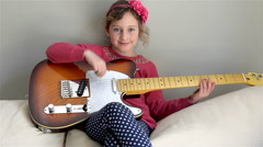 Young girl with a rock guitar  Arkistovideo