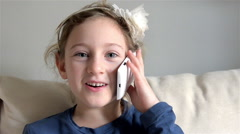 Smiling child with telephone Stock Footage
