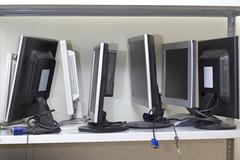 lot of broken monitors awaiting repair - stock photo