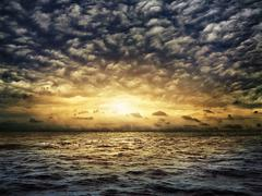 Dark stormy sea with a dramatic cloudy sky Stock Photos