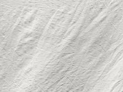 Coarse texture of crumpled white tissue Stock Photos