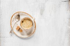 Black coffee on a lite wooden background Stock Photos