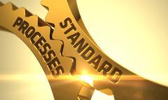 Standard Processes on Golden Metallic Cogwheels - stock illustration