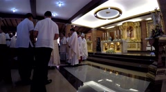 Priests march in recession after holy mass - stock footage