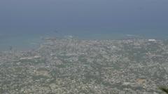 Timelapse view overlooking oceanside city Stock Footage