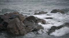 Water splashing against rocks Stock Footage