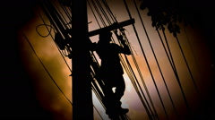 Silhouette Electrician wiring Newly on Pole - stock footage