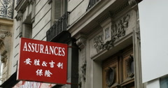 Chinese insurance in Paris Stock Footage