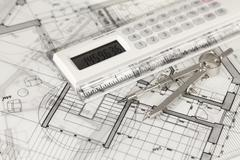 Architecture blueprints -  house plans,  compass and electronic calculator Kuvituskuvat