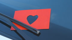 Confessions on a Windshield - Paper Cut - Heart Shape - camera pan Stock Footage