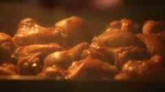 Chicken drummets deep frying in oil Stock Footage