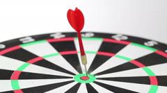 Red Dart hit bullseye, high angle Stock Footage