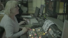 The woman directed the live broadcast at work in TV studios Stock Footage