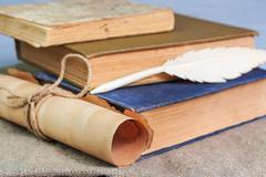 Stack of old books and manuscript on the table Stock Photos