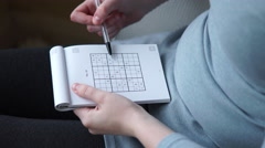 4k Caucasian hands solving a sudoku with biro pen Stock Footage
