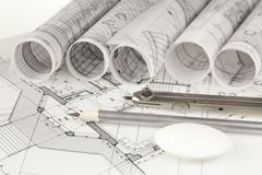 Rolls of architecture blueprints and house plans Stock Photos