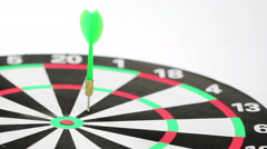 Six darts in red and green color hitting the dartboard, low angle shot, white ba - stock footage