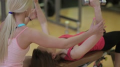 Girlfriends training with dumbbells in the gym Stock Footage