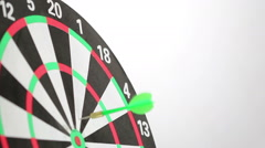 Three green darts followed by three red darts hitting the dartboard - stock footage