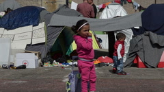 EDITORIAL:  Little children of Syrian refugees walk in a refugee camp Stock Footage