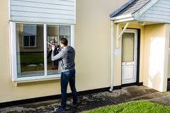 Man using pest control injection Stock Photos