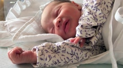 Newborn 2 days old baby sleeping in the crib Stock Footage