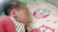 Newborn 8 days old baby sleeping in the crib Stock Footage