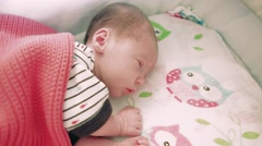 Newborn 8 days old baby sleeping in the crib - stock footage