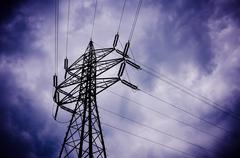 Dramatic stormy clouds with silhouette of electrical wiring Stock Photos