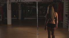 beautiful blonde is dancing sexy pole dance - stock footage