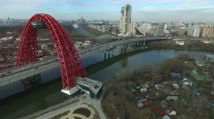 Aerial view of modern cable-stayed Zhivopisny bridge over Moskva River - stock footage
