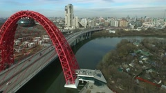 Aerial view of modern cable-stayed Zhivopisny bridge over Moskva River Stock Footage