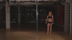 Beautiful blonde is dancing sexy pole dance Stock Footage