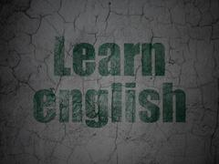 Learning concept: Learn English on grunge wall background Stock Illustration