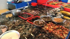 View to the stall with fish and seafood at the fish market in Busan, Korea. Stock Footage