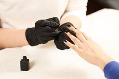 The process of coating varnish manicure Stock Photos