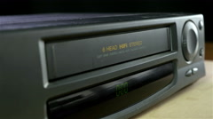 Inserting a VHS Tape into a VCR Player Stock Footage