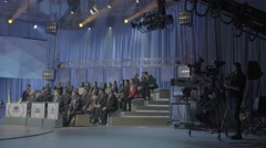The audience in the TV Studio during the recording of the talk show - stock footage