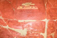 Detail of red pompeian fresco Stock Photos