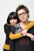 Japanese couple hugging - stock photo