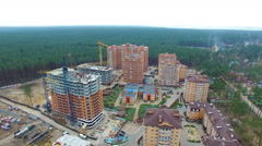 Unfinished construction of multi-storey buildings. aerial drone video Stock Footage