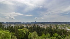 Time lapse of clouds and blue sky over cityscape of Eugene Oregon spring 4k - stock footage