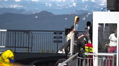 Gondola Unload: Family Unloading from a Gondola at Ski Resort - stock footage