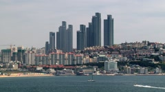 View to the city from the seaside viewpoint in Busan, Korea. Stock Footage
