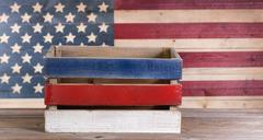 Fourth of July crate on rustic wood - stock photo