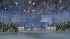 TV Studio with a presenter and the audience during the recording of the show - stock footage